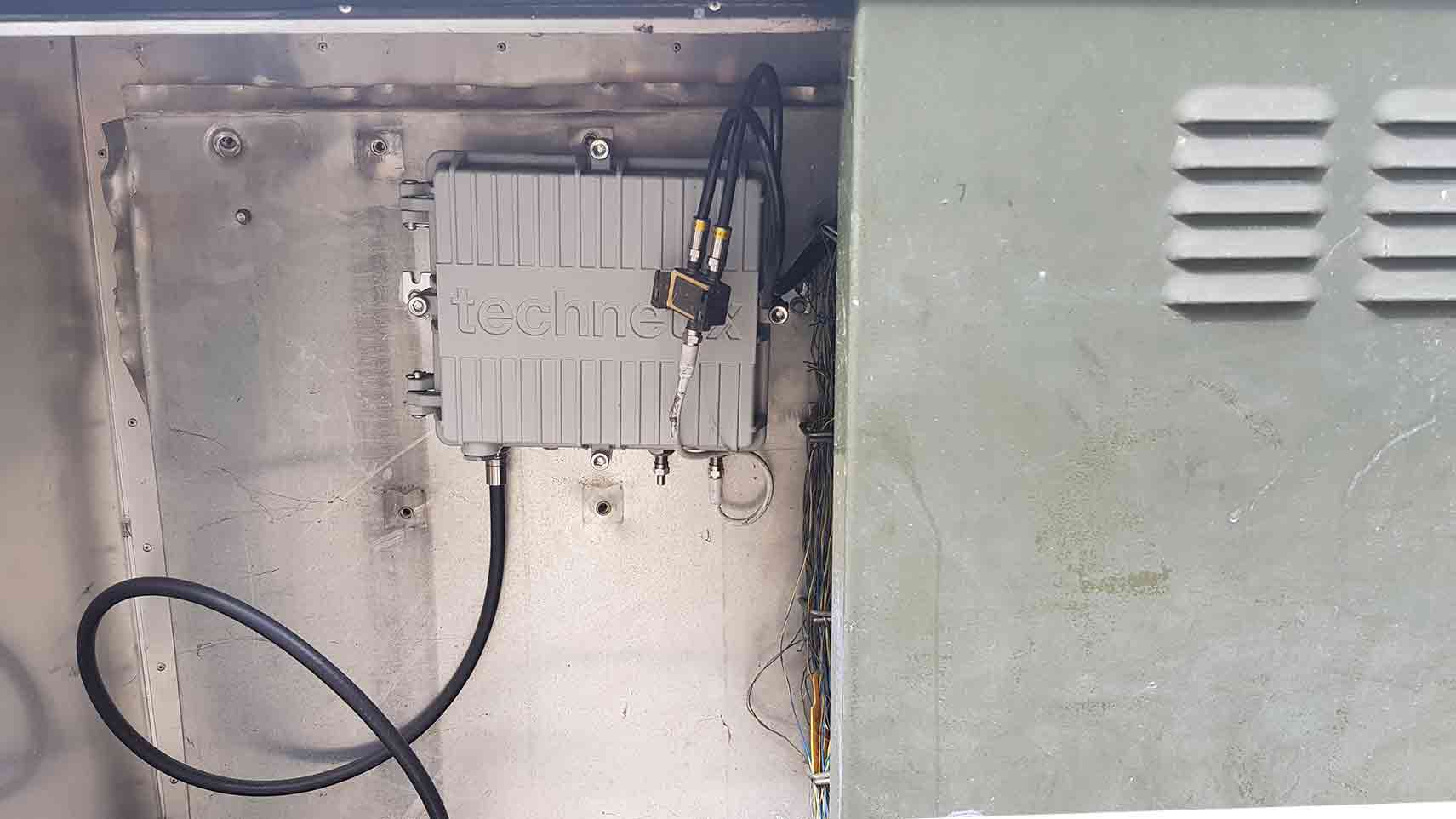 A photograph of the inside of a telecommunications box.